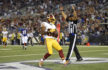 Washington Redskins wide receiver Jamison Crowder jogs into the end zone for a touchdown in the first half of a preseason NFL football game against the Baltimore Ravens, Saturday, Aug. 29, 2015, in Baltimore. (AP Photo/Nick Wass)